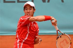 Kei Nisikori follows through on a forehand in his match against Federer (Thanks to timesofindia.indiatimes.com)